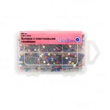 Булавки с круглыми головками различных цветов в пластиковом органайзере